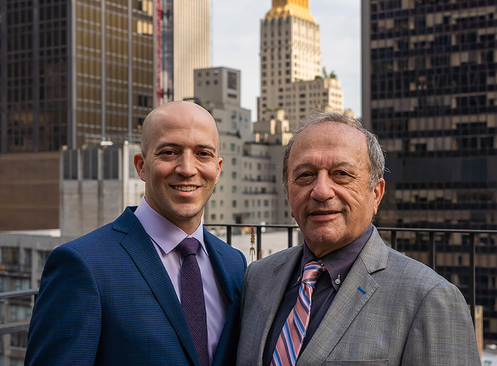 Drs. Matthew and Sheldon Nadler with the NYC skyline in the background