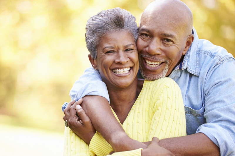 Middle-aged African American couple with perfect teeth