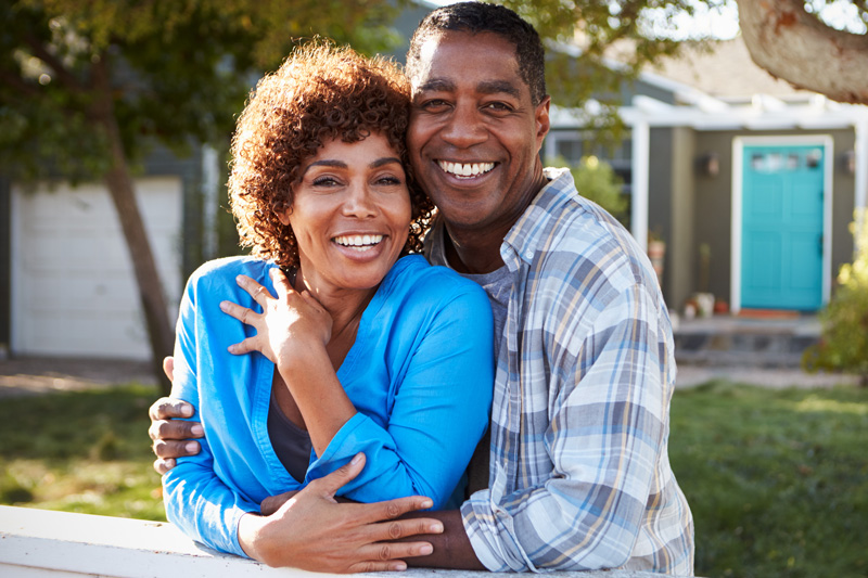 African American couple with white teeth, smiling